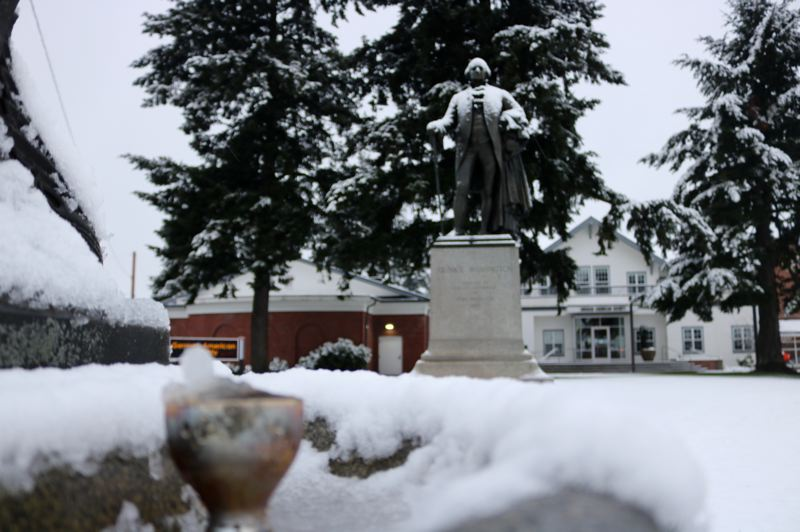 PMG PHOTO: ZANE SPARLING - A Benson Bubbler froze over in Northeast Portland. The snowy scene was surveiled by a statue of President George Washington.