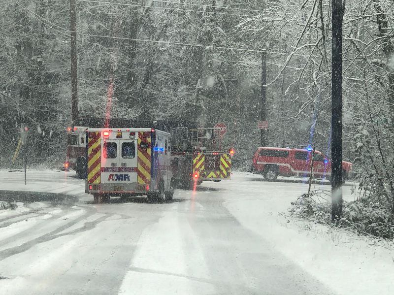 PMG PHOTO: MARK GARBER - The scene of a snowy car crash in East Multnomah County on Saturday is shown here.