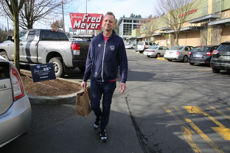 KATE DAVIDSON/OPB - Full-service Instacart shopper Carl Momberger heads out to make a grocery delivery in Portland, Ore. on March 5, 2020. He said orders flooded in when the first COVID-19 cases were announced in the state.