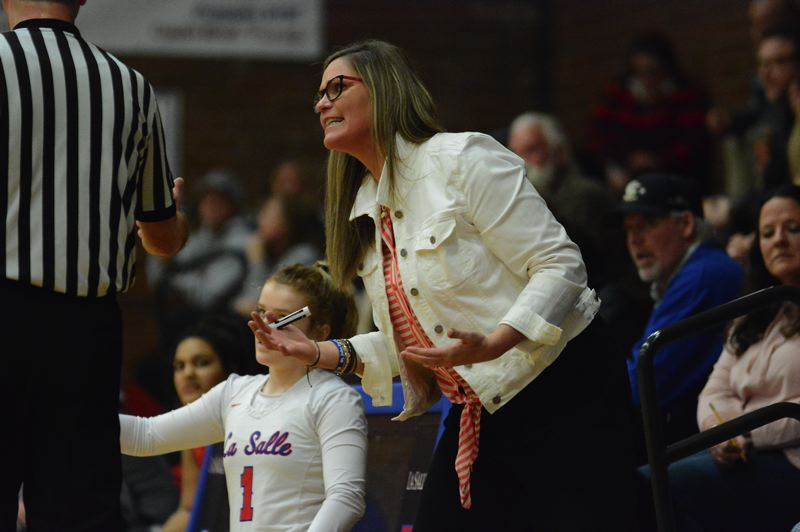 PMG PHOTO: DAVID BALL - La Salle Prep coach Kelli Wedin pleads her case to an official during the Falcons' 97-41 blowout win over Ashland in the first round of the OSAA 5A girls basketball playoffs on March 6.