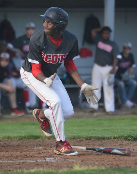 PMG PHOTO: DAVID BALL - David Douglas Jermaine Robinson drops his bat while watching a foul tip head into the fence. The OSAA has put the prep spring sports season on hold until at least April 1.