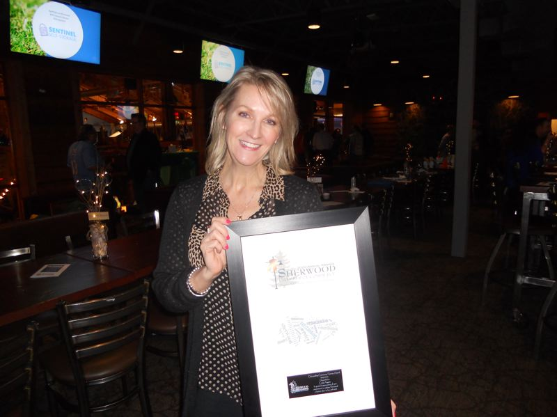 PMG PHOTO: SCOTT KEITH - Cindy Aggson, organizer of the Give n' Gobble, received the Outstanding Community Service Award.