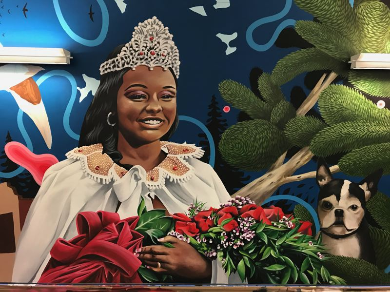 COURTESY PHOTO - Who'll be the next Rose Festival queen? Princess announcements continue this week, virtually, rather than at Lloyd Center. Here's an image of Mya Brazile, the 2019 Rose Festival queen, in the 'Street' Art mural created by local artists Alex Chiu and Jeremy Nichols for the north pedestrian tunnel at Portland International Airport.