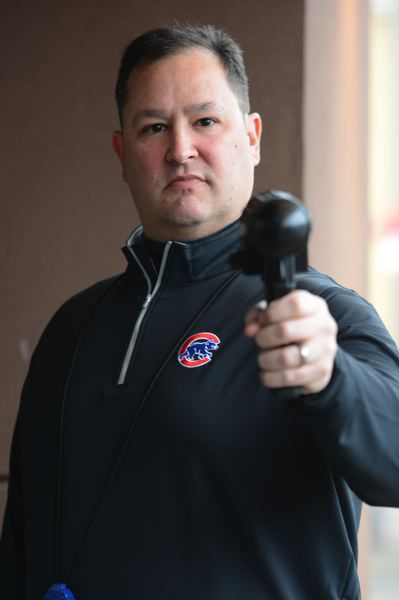 PMG PHOTO: DAVID BALL - The radar gun is a tool of the trade for Sandy, who tours the Northwest and Canada in search of young talent.