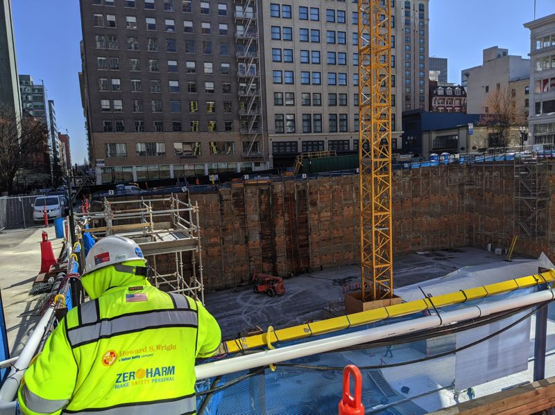 PMG: JOSEPH GALLIVAN  - A worker checks out the excavation at Southwest 10th Ave. and Washington St. of the foundation for the coming Ritz-Carton hotel/condo/office/retail tower.