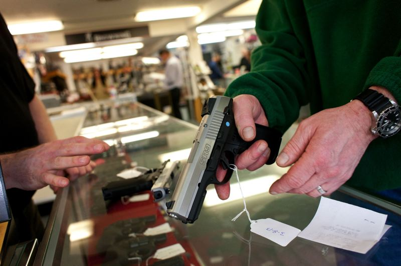 PMG FILE PHOTO - Oregonians are buying guns about as fast as they're snapping up toilet paper. A Southeast gun store owner says he's never seen anything like it.