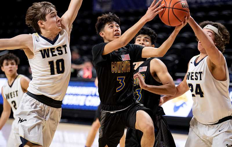 LON AUSTIN/CENTRAL OREGONIAN - Jrei Ramirez drives to the basket during the Cowboys state tournament victory over the West Albany Bulldogs last Thursday. Ramirez is one of four seniors on the Crook County roster.