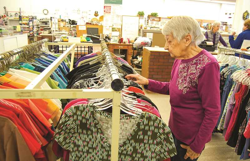 RAMONA MCCALLISTER - Volunteer Ruth Kandle puts out retail items at the Neat Repeat. She has been volunteering for 22 years.