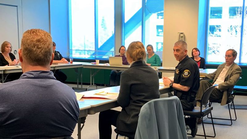 COURTESY WASHINGTON COUNTY SHERIFF'S OFFICE - Sheriff Pat Garrett, in uniform, speaks at a gathering of justice system leaders Monday, March 16, at the Law Enforcement Center in Hillsboro. He then announced several measures to avert the spread of the COVID-19 virus and reduce the population of the Washington County Jail.