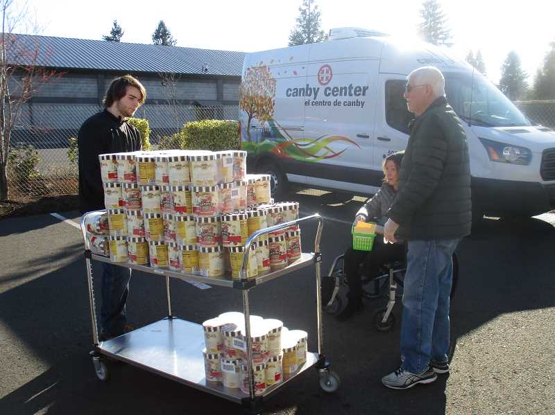 DEBORAH GUINTHER - A load of ice cream arrived at The Canby Center Tuesday morning as the food pantry was held outdoors. The Canby Center continues to try and help during the COVID-19 scare, though it has amended some of its programs for the time being.