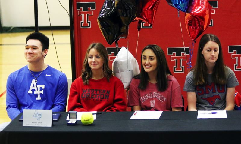 PMG PHOTO: DAN BROOD - Tualatin High School seniors (from left) Kainoa Sayre, Bella Valdes, Halle Mitchell and Kaitlyn Gearin signed their college national letters of intent during a ceremony at the school.