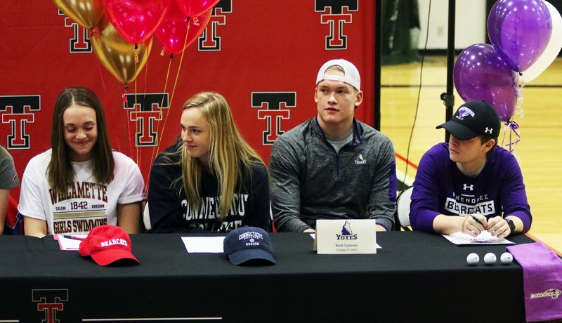 PMG PHOTO: DAN BROOD - Tualatin High School seniors (from left) Britney Muralt, Sarah Hall, Brett Gydesen and Bryce Hatcher signed their college national letters of intent during a ceremony at the school.