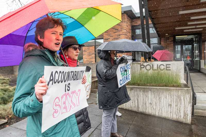 PMG PHOTO: JONATHAN HOUSE - From left, Claire and Mary Baumgardner rally outside the West Linn Police Station saturday afternoon as part of the Concerned Citizens of West Linn's March Against Racism.