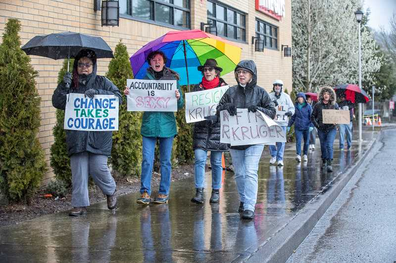 PMG PHOTO: JONATHAN HOUSE - The Concerned Citizens of West Linn march in the rain during a demonstration to asks for reforms from the Police Department.