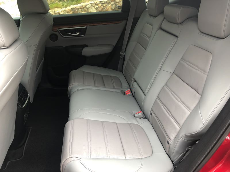 PMG PHOTO: JEFF ZURSCHMEIDE - Rear seat room in the 2020 Honda CR-V Hybrid is very good for a compact crossover.