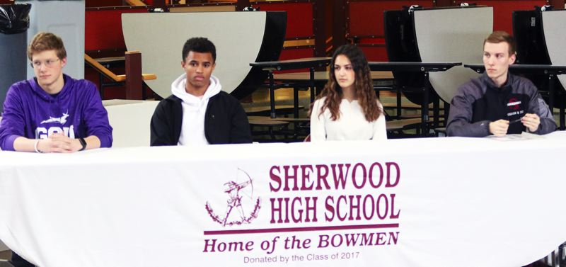 PMG PHOTO: DAN BROOD - Sherwood High School seniors (from left) Jacob Folsom, Caleb Hagan, Alycia Alvarado and Thomas Osborne signed the college national letters of intent during a ceremony at the school.