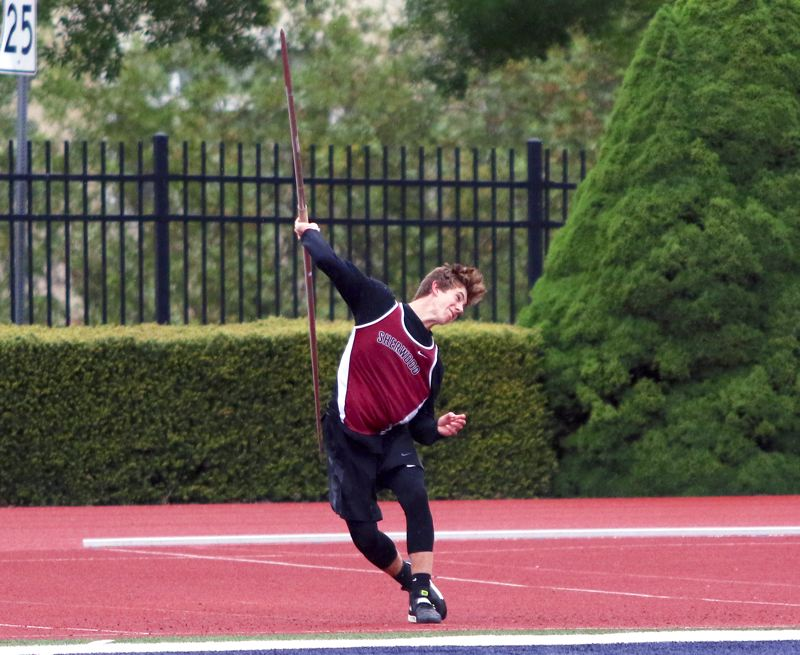 PMG FILE PHOTO: DAN BROOD - Sherwood High School junior Asher Krauel, shown here at last year's Pacific Conference district track and field meet, and his Bowmen teammates are hoping they get a chance to win a state title  this year.