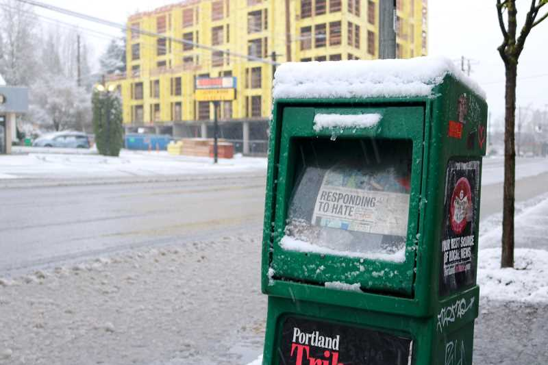 PMG PHOTO: ZANE SPARLING - Snow covers a Portland Tribune newspaper box on Saturday, March 14. Since the COVID-19 pandemic hit Oregon, several news organizations have slashed staffing and print products.