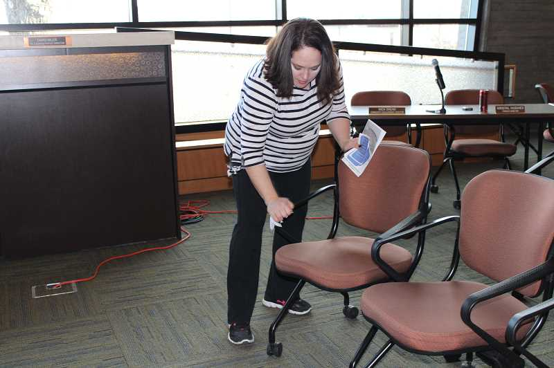 TERESA JACKSON/MADRAS PIONEER - Charo Miller, city of Madras human resources director, cleans chairs after Coffee Cuppers at Madras City Hall Friday, March 13. The City Council briefly discussed options for meeting online at its Tuesday, March 10 meeting.