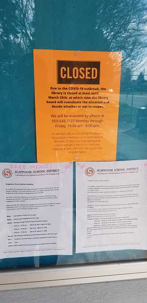PMG PHOTO: DARRYL SWAN - Signs posted on the Scappoose Public Library message board announce the closures, meal services and other messages associated with the novel coronavirus outbreak. As of Wednesday, March 18, at 12:30 p.m. no cases had been reported in Columbia County.