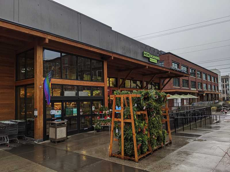 PMG PHOTO: JOSEPH GALLIVAN - The entrance to the Slabtown New Seasons Market. New Seasons is one of a few grocers who announced a special shopping hour would be set aside for seniors and vulnerable populations before store hours, in light of the novel coronavirus.