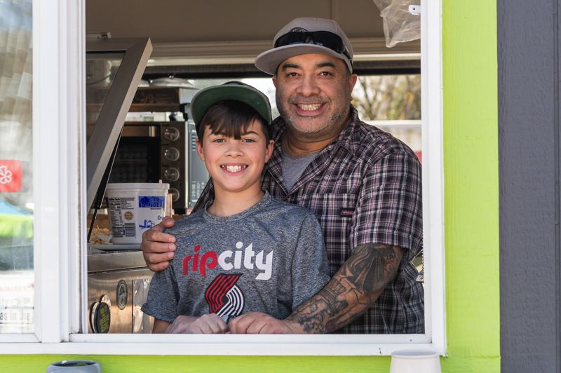 PMG PHOTO: CHRISTOPHER OERTELL - Jose Cassady and his son, Jaxton, at the Forest Grove Sandwich Shop on Wednesday, March 18.