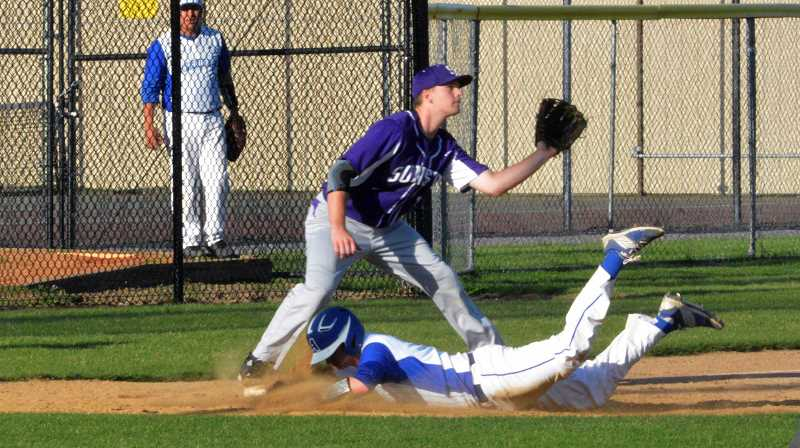 PMG FILE PHOTO - Aloha shortstop Kadn Knight slides into third baseman during the Warriors 4-3 win over Sunset in 2016.