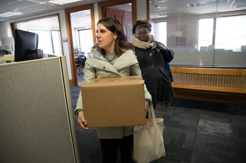 COURTESY PHOTO - Multnomah County Chair Deborah Kafoury moved her office across the Willamette on Wednesday. She's followed by her chief of staff, Kim Melton, while entering a conference room at county health headquarters building in Northwest Portland. She said the move will help her make better decisions as county personnel there react to a rapidly changing situation.