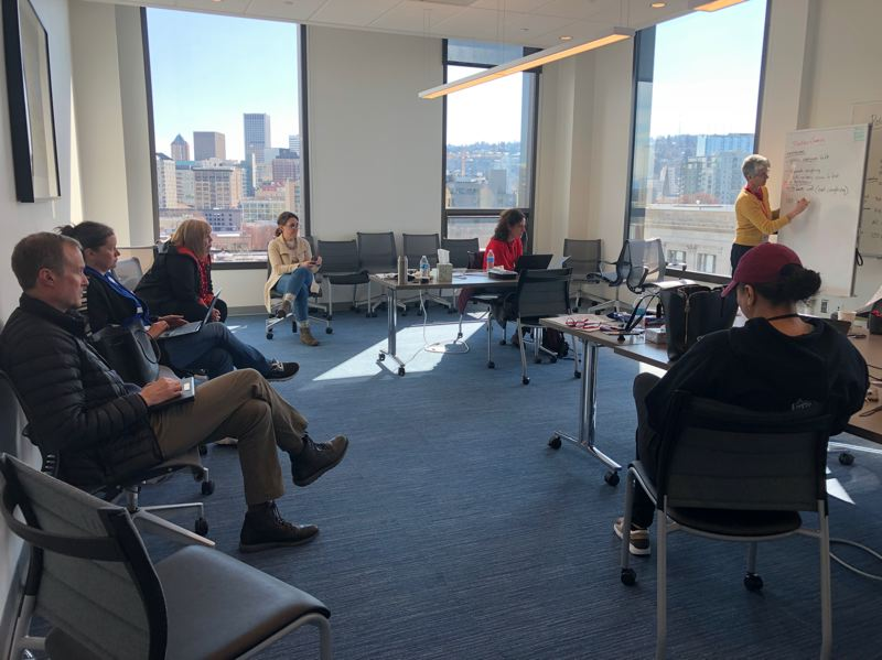 COURTESY OF MULTNOMAH COUNTY - Multnomah County Chair Deborah Kafoury (sitting in front of window at far wall) and county staff met for hours at the Gladys McCoy building on Sunday to discuss public health measures to combat the spread of coronavirus.