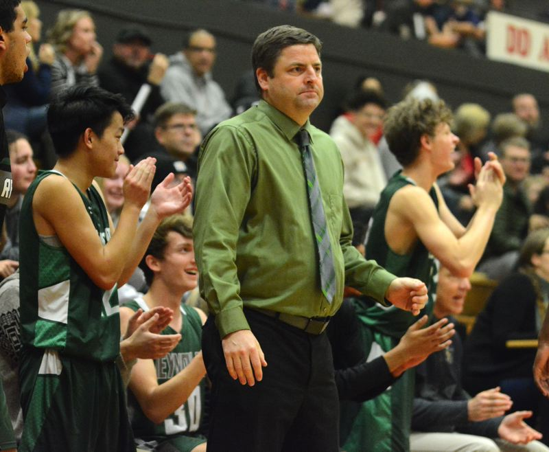 PMG PHOTO: DAVID BALL - Reynolds coach Ted Aubin works to keep his Raiders motivated through some long seasons.