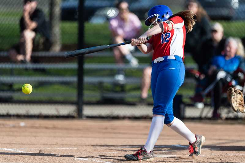 PMG PHOTO: CHRISTOPHER OERTELL - Hilhi's Sydney Lierman takes a swing during a Spartans softball game last season at Hillsboro Stadium.