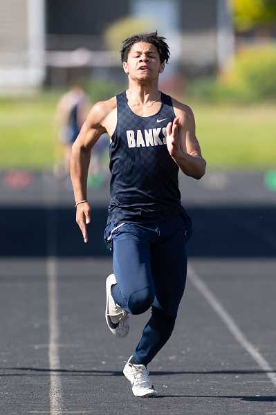 PMG PHOTO: CHRISTOPHER OERTELL - Banks' Jamar Flippen competes during a Braves track and field meet last season at Banks High School.
