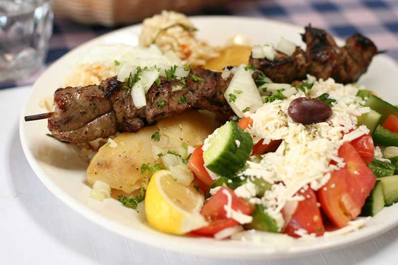 COURTESY PHOTO  - Greek cuisine features olive oil, lemon, garlic, feta and oregano. Lamb and fish are popular proteins.