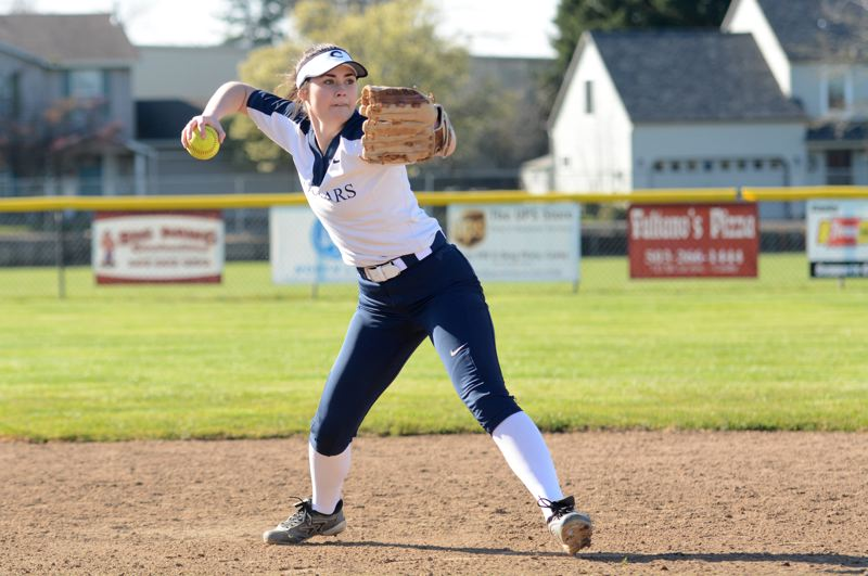 PMG PHOTO: DEREK WILEY - Canby senior shortstop Nicole Michelson throws the ball to first base during softball practice before the spring season was suspended through April 28.
