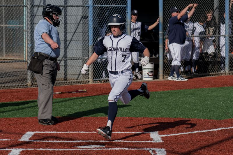 COURTESY PHOTO: GREG ARTMAN - Wilsonville baseball player Jarrod Seibel crosses home plate during a game played last season. The 2020 spring season has been suspended until at least April 28.