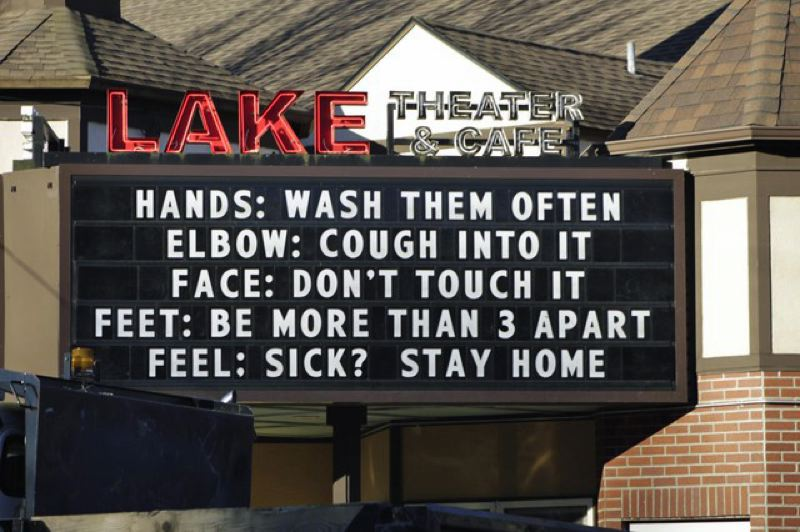 COURTESY PHOTO: OPB - A checklist for COVID-19 health outside a theater in Lake Oswego.