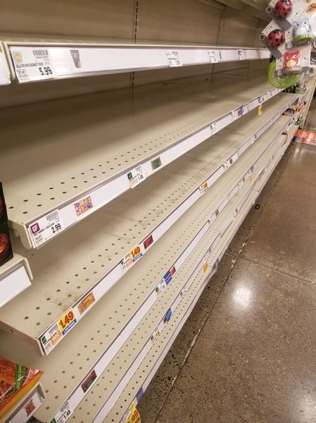 PMG PHOTO: CHRISTOPHER KEIZUR  - Local grocery store are having trouble keeping items like rice, bread and toilet paper stocked.