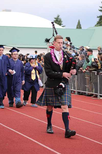 PMG FILE PHOTO: KRISTEN WOHLERS - Principal Greg Dinse marches in full Highland dress, playing the bagpipes at Canby High Schools 2019 graduation.