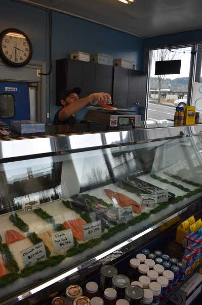 PMG PHOTO: RAYMOND RENDLEMAN - Greg Petrich, retail manager of Tony's Fish Market in Oregon City, has been assuring customers of continued fresh supplies during the coronavirus outbreak.