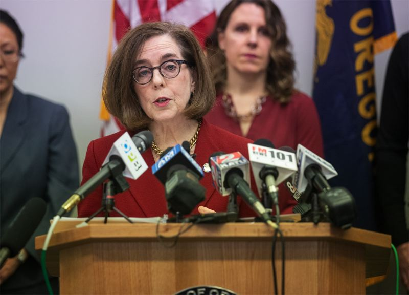 PMG PHOTO BY JONATHAN HOUSE - Gov. Kate Brown, Multnomah County Chair Deborah Kafoury and Portland Mayor Ted Wheeler on Friday evening announced stronger social distancing measures that included a ban non-essential trips. This photo was taken at a previous press conference.