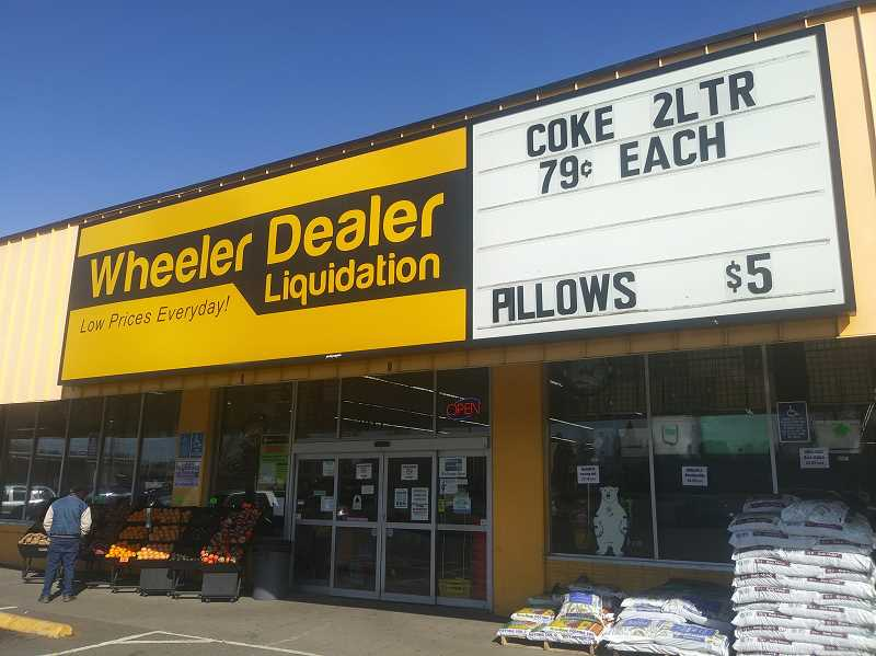 PMG PHOTO: JUSTIN MUCH - Wheeler Dealer Liquidators, which has stores in Woodburn, Salem and Albany, has its worker attending to heightened cleaning tasks in high traffic areas amid concerns about the coronavirus.