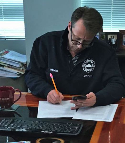 COURTESY PHOTO: SHANE BEMIS - Gresham Mayor Shane Bemis signs a letter to Oregon Gov. Kate Brown calling for stronger quarantine measures statewide on Saturday, March 21.