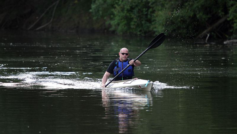 PMG PHOTO: MILES VANCE - Tigard City Councilor John Goodhouse kayaks along the Tualatin River in Cook Park during a friendly competition between local political figures in 2016.