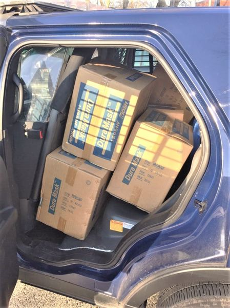 COURTESY PPB - Boxes of recovered stolen respirators in the back of a Portland police vehicle.