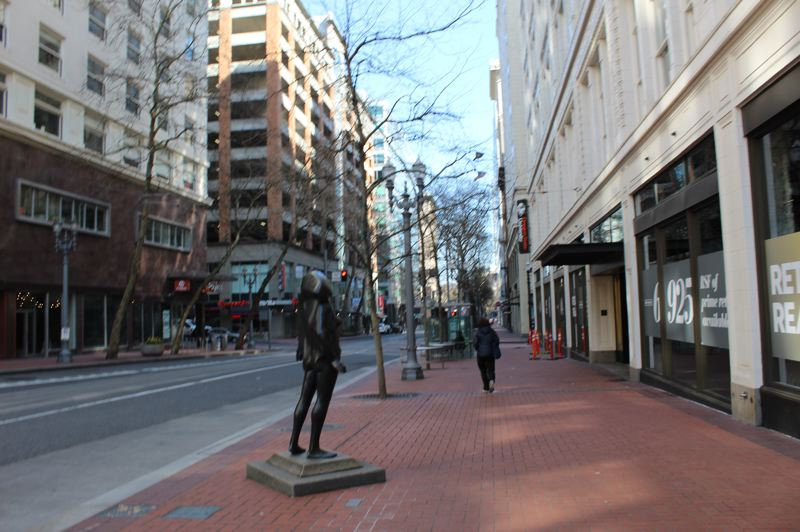 PMG: JOSEPH GALLIVAN - Southwest Fifth Avenue in downtown Portland on Thursday March 19, 2020. Rite Aid and the shoe repair store were open, but very little else was as businesses stayed closed because of the coronavirus or the lack of customers.