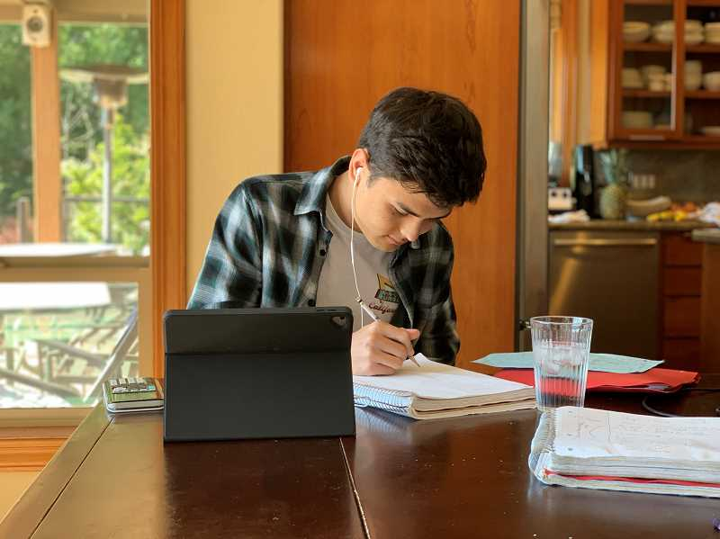 COURTESY PHOTO - Despite the statewide closure of schools, La Salle Prep students such as Lucas Wobig can study at home thanks to digital learning lessons the school began regularly holding three years ago.