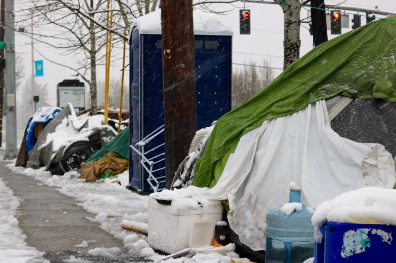 PMG PHOTO: ZANE SPARLING - Snow fell on homeless camps in the Cully neighborhood of Northeast Portland on Saturday, March 14. , Portland Tribune - News Snow falls throughout the greater Portland region, even covering the lower elevations on Saturday, March 14.  Winter Weather Advisory: Metro area wakes to snow