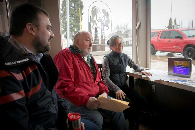 PMG PHOTO: JAIME VALDEZ - Brandon Petersen, left, Marland Henderson and Suenn Ho sit next to a window at Symposium Coffee that overlooks the Tigard Street Heritage Trail and Outdoor Musuem where a Rotary Plaza clock will soon be installed.