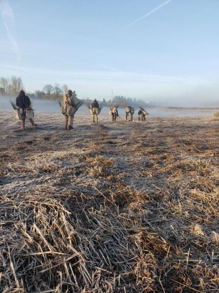 COURTEST PHOTO: TUALATIN RIVER NATIONAL WILDLIFE REFUGE - Tree planting crews get set up to plant 100,000 trees near a frosty wetland in the Tualatin River National Wildlife Refuge on Tuesday morning, March 17.