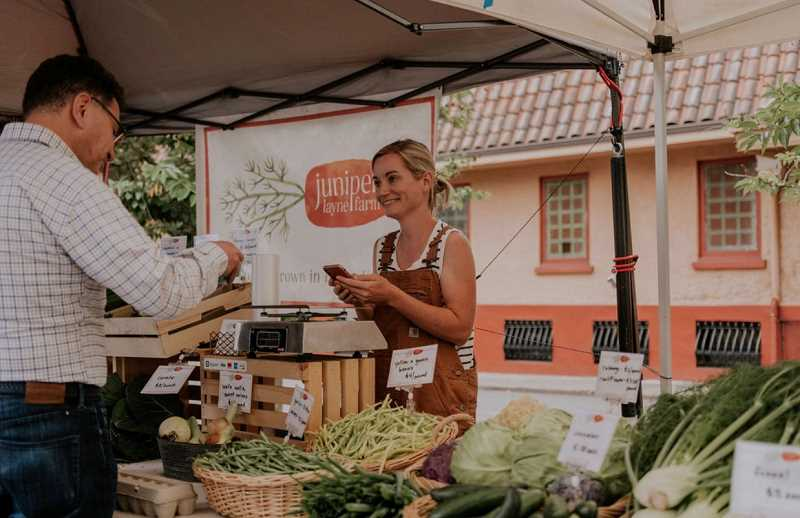 COURTESY PHOTO - Jen Browning greets customers at last year's Moreland Farmers Market.